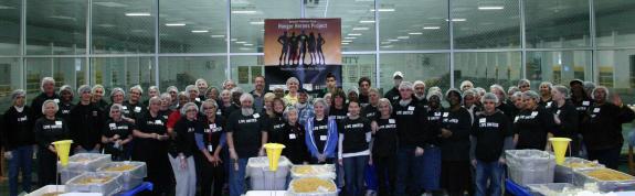 Volunteers package 25,000 meals for local pantries
