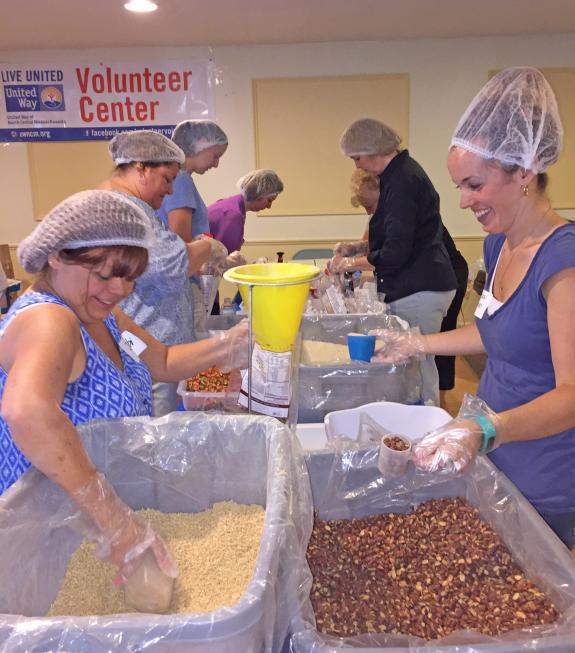 Town & Country Apartment residents and community volunteers package 20,000 meals for food pantries